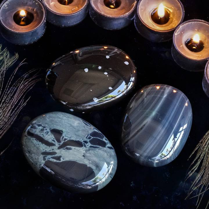 intuitively chosen obsidian palm stones